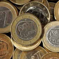 Greek one-euro coins are seen in Athens